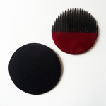 A lacquered comb in its leather case. 120 €. Michael Verheyden http://www.michaelverheyden.be