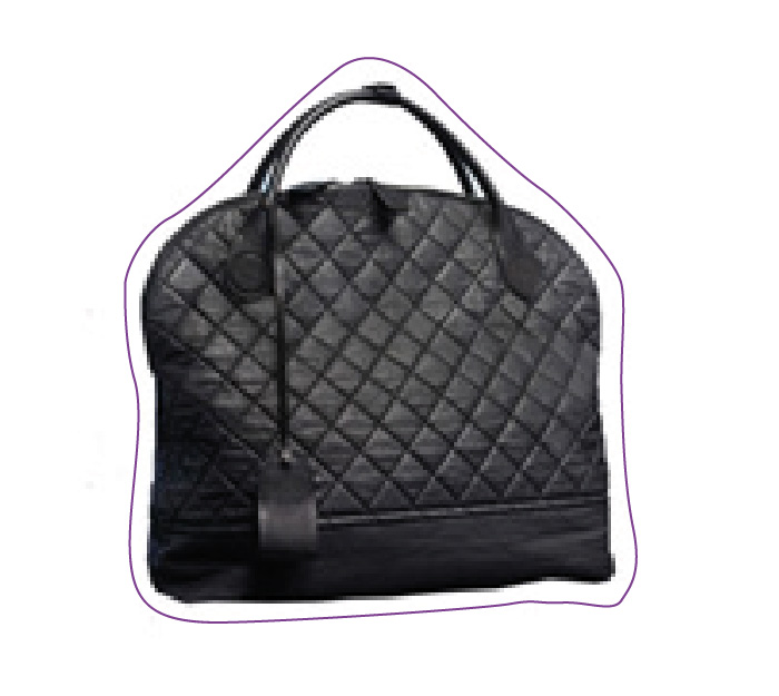 A Chanel canevas garment bag.
