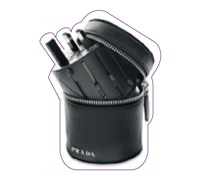 Prada multiple adapter in a leather case.