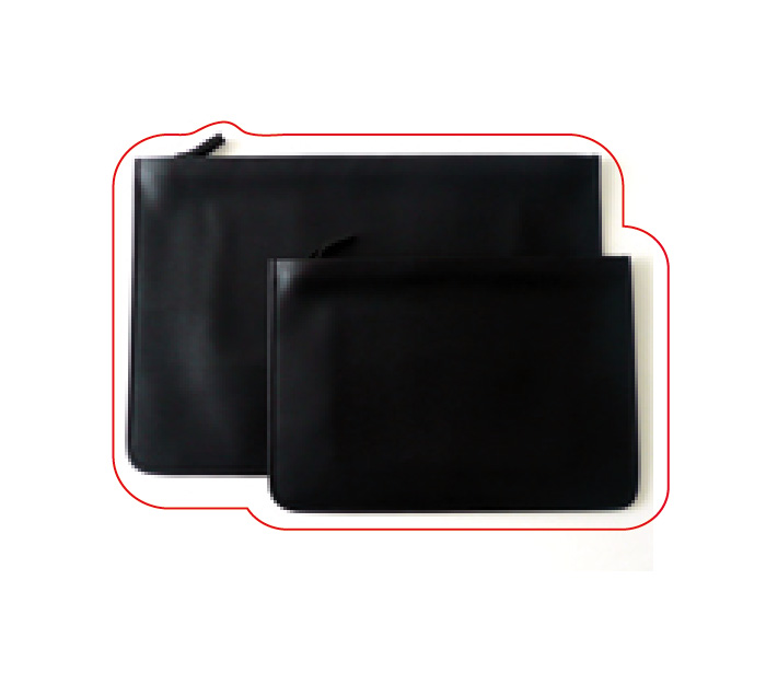 Ultra flat black leather pouches. Michael Verheyden