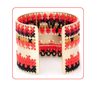 Embroidered brass cuff by Camille Enrico.