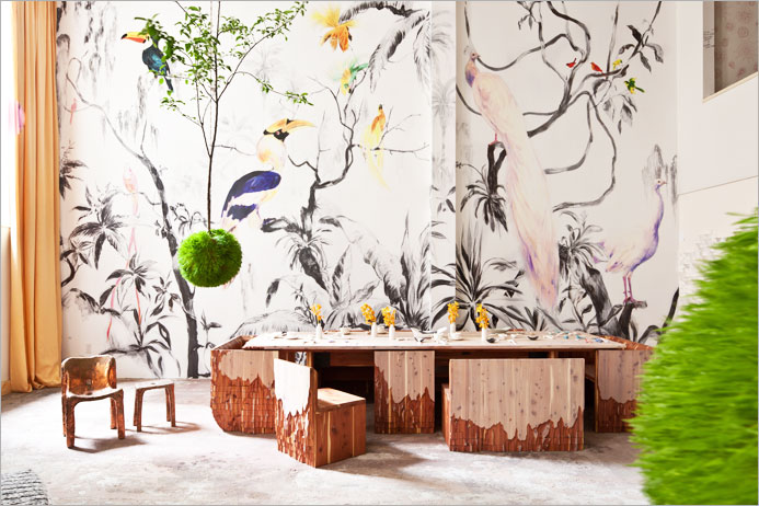 Monolith table custom-made sculpted by New York designer Alex Gil and lush 'Tropical Birds' wallpaper designed by Argentine born printed in collaboration with Tres Tintas Barcelona