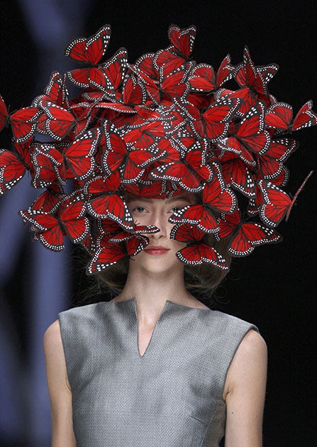 """Alexander McQueen: Savage Beauty"" at the Victoria and Albert Museum, London. Butterfly headdress of hand-painted turkey feathers. By Philip Treacy for Alexander McQueen, La Dame Bleu. Spring Summer 2008. © Anthea Sims. Courtesy of Victoria & Albert Museum"