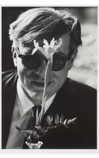 Andy Warhol with Flower, Scratching the Surface : Photographs by Dennis Hopper, Gagosian Gallery. Courtesy Gagosian Gallery